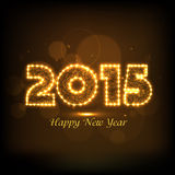 Happy New Year 2015 celebration with shiny text. Greeting card design with shiny 2015 text covered by lights for Happy New Year celebration on brown background Royalty Free Stock Photos