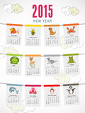 Happy New Year 2015 celebration with yearly calendar. Yearly calendar of 2015 with animal cartoons on cloudy background for Happy New Year celebrations stock illustration