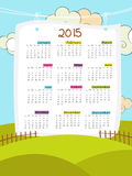 Happy New Year 2015 celebration with yearly calendar. Annual calendar of 2015 hanging on cloudy background for Happy New Year celebrations Royalty Free Stock Images