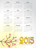 Happy New Year 2015 celebration with yearly calendar. Calendar of 2015 with branch of pink flowers for Happy New Year celebrations vector illustration