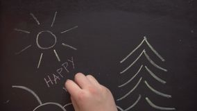 'Happy new year ' on chalk board. drawing chalk. The girl draws the picture chalk stock video footage