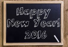 Happy New Year! 2016. New chalkboard with 3D outlined text - on wood Royalty Free Stock Photo