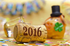 Happy new year 2016 with champagne cork. And pig made with marzipan as lucky charm Stock Image