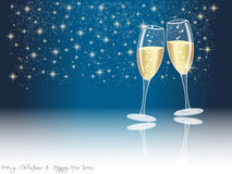 Happy new year champagne glasses. New years eve concept with champagne glasses on dark blue sky background and copy space Stock Images