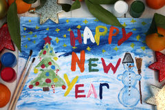 Happy New Year. Children`s drawing with a snowman and a Christmas tree and the words `Happy New Year`. Happy New Year: colored letters, tangerines and spruce Stock Images