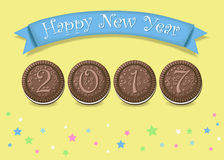 Happy New Year 2017. Chocolate cookies. Happy New Year 2017. Calendar template. Hand drawn symbols. Chocolate cookies with graceful decor. Celebration background Stock Photo