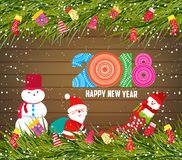 Happy new year 2018, christmas background with snowman and santa claus on wood.  Stock Photo