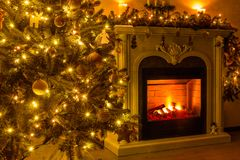 Happy new year and christmas. A cozy room where a fireplace burn stock image