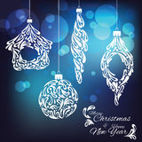 Happy New year and Christmas greeting card. Ornamental new year toys on abstract background Royalty Free Stock Images