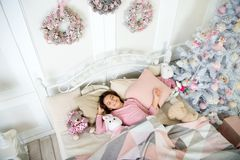 Happy new year. Christmas shopping. The morning before Xmas. Sleep. waiting for santa. Winter. little child girl with. Xmas present. small girl sleeping at home royalty free stock image