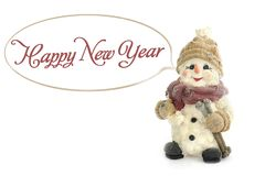 Happy New Year. Snowman standing in the snow, on a background of snow stock photo
