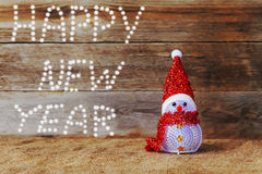 Happy new year, christmas, snowman. On wood background Stock Photos