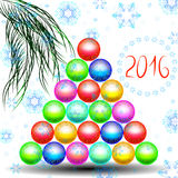 Happy new year with Christmas tree of Christmas toys. Unusual Christmas tree of Christmas balls on which the falling snowflakes, with a sprig of fir Royalty Free Stock Image