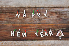 Happy new year and christmas tree on wooden background Royalty Free Stock Photos