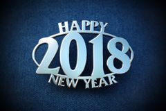 Happy new year 2018 chrome badge on jeans Royalty Free Stock Photos