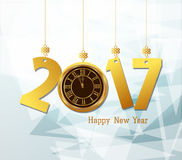 Happy new year 2017 with clock abtract background.  Royalty Free Stock Image