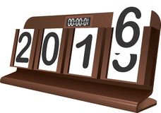 Happy New Year 2016 in Clock Calender. A Clock Calender with 2015-2016 change on a board table represents the new 2016 Royalty Free Stock Photo