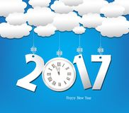 Happy new year 2017 with clock, cloud and sky background.  Stock Images