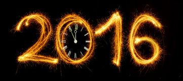 Happy New Year - 2016 with clock face made with sparklers on bla Stock Image