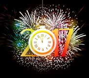 Happy New Year 2017 clock and Fireworks colorful.  Stock Image