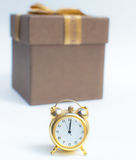 A Happy New Year Clock Striking Midnight. With present gift box Stock Images