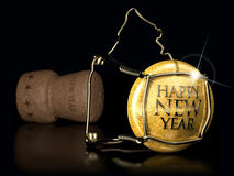 Happy New Year. Close up of champagne cork on black background Stock Images