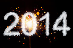 Happy New Year 2014. Cloud style text with sparkler Royalty Free Stock Image