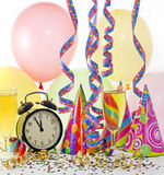 Happy new year colorful background party. Happy new  year background with glass of champagne clock serpentines confetti and balloons Royalty Free Stock Images