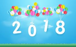 Happy new year 2018 with Colorful balloons flying over grass. Paper art and craft style. Design stock illustration