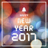 Happy new year 2017 on colorful bokeh background Stock Photography