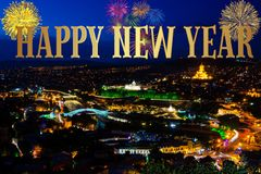 Happy New Year colorful background. Happy New Year colorful card with city panorama and fireworks Royalty Free Stock Photography