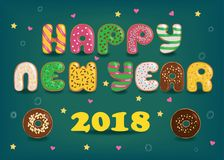 Happy New Year 2018. Colorful donuts stock photo