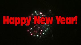 Happy New Year with colorful fireworks. Happy New Year words with colorful fireworks display in the background stock footage