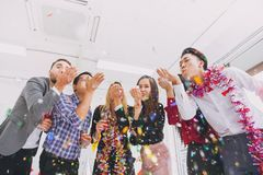 Happy new year colorful party in office business people royalty free stock photo