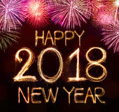 HAPPY NEW YEAR 2018. From colorful sparkle on black background with celebration fireworks light Stock Image