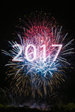 Happy New Year 2017. With colorful sparklers. The numbers 2017 are integrated into the fireworks with black background