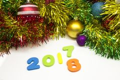 2018 happy new year colourful tinsel decoration background Royalty Free Stock Photo