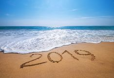Happy New Year 2019 is coming concept sandy tropical ocean beach. Lettering concept image and royalty free stock image