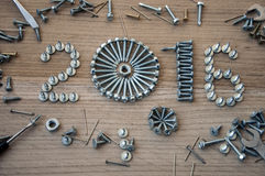 Happy new year 2016 composition with screws nails bolts and dowels Royalty Free Stock Photo