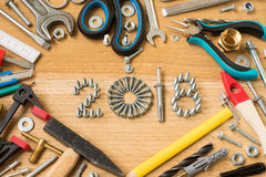 Happy new year 2018. Composition with screws, nails,  bolts , dowels and tools on wooden background. New year. New year background Royalty Free Stock Photos