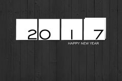 2017 Happy New Year Concept  background 02. 2017 Happy New Year Concept, Texts on White Square Labels on Grey Wall Texture Royalty Free Stock Photos
