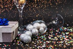 Happy new year concept with champagne glasses and confetti royalty free stock photography