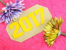 Happy new year concept decoration with artificial flower Stock Image