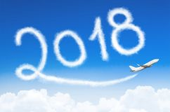 Happy New year 2018 concept. Drawing by airplane vapor contrail in sky. Happy New year 2018 concept. Drawing by airplane vapor contrail in sky Royalty Free Stock Photo
