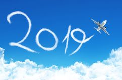 Happy New year 2019 concept. Drawing by plane vapor contrail in sky.  royalty free stock photo