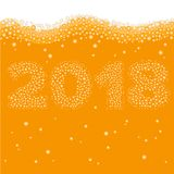 Happy New Year 2018 concept. Number created of bubbles inside orange liquid - juice, beer or champaign. Celebration logo or xmas poster template Stock Photography