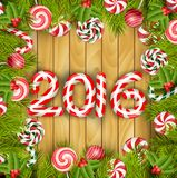 Happy new year 2016 with concept lollipops and pine tree on wooden background. Illustration of Happy new year 2016 with concept lollipops and pine tree on wooden Stock Photos