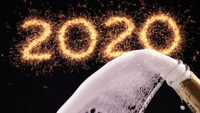Happy new year 2020 concept. Opening a champagne bottle.