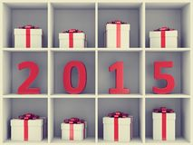 Happy New Year concept. 2015 new year concept. Red number characters and gift boxes placed on white book shelf Stock Photography