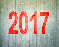 2017 happy new year concept. Red number on wooden wall Stock Photography
